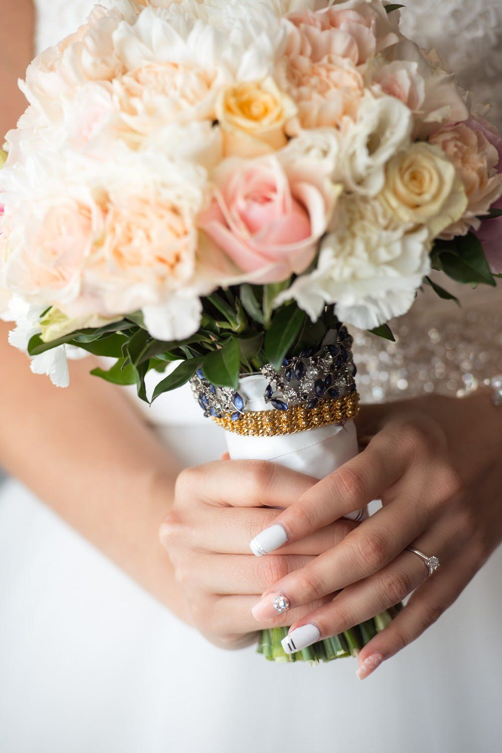 Engagement ring wedding flowers bridal brides bouquet